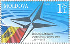 Emblem of NATO and the Flag of Moldova