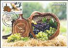 Carved Wooden Flask and a Basket of Grapes